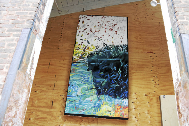 "This painting titled ""Palette"" hangs at the Greylock WORKS entrance on Thursday. The painting was done by Soldier On participants Ray Voide and John Goodro as part of a community engaging art partnership with the Williamstown Theater Festival. (Sue Bush — The Berkshire Eagle)"
